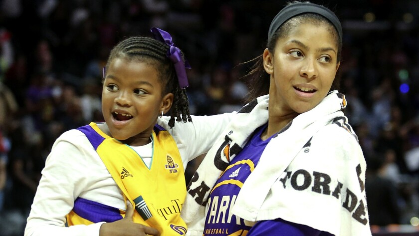 Sparks star Candace Parker holds daughter Lailaa after a WNBA playoff game against the Sky on Sept. 30, 2016.