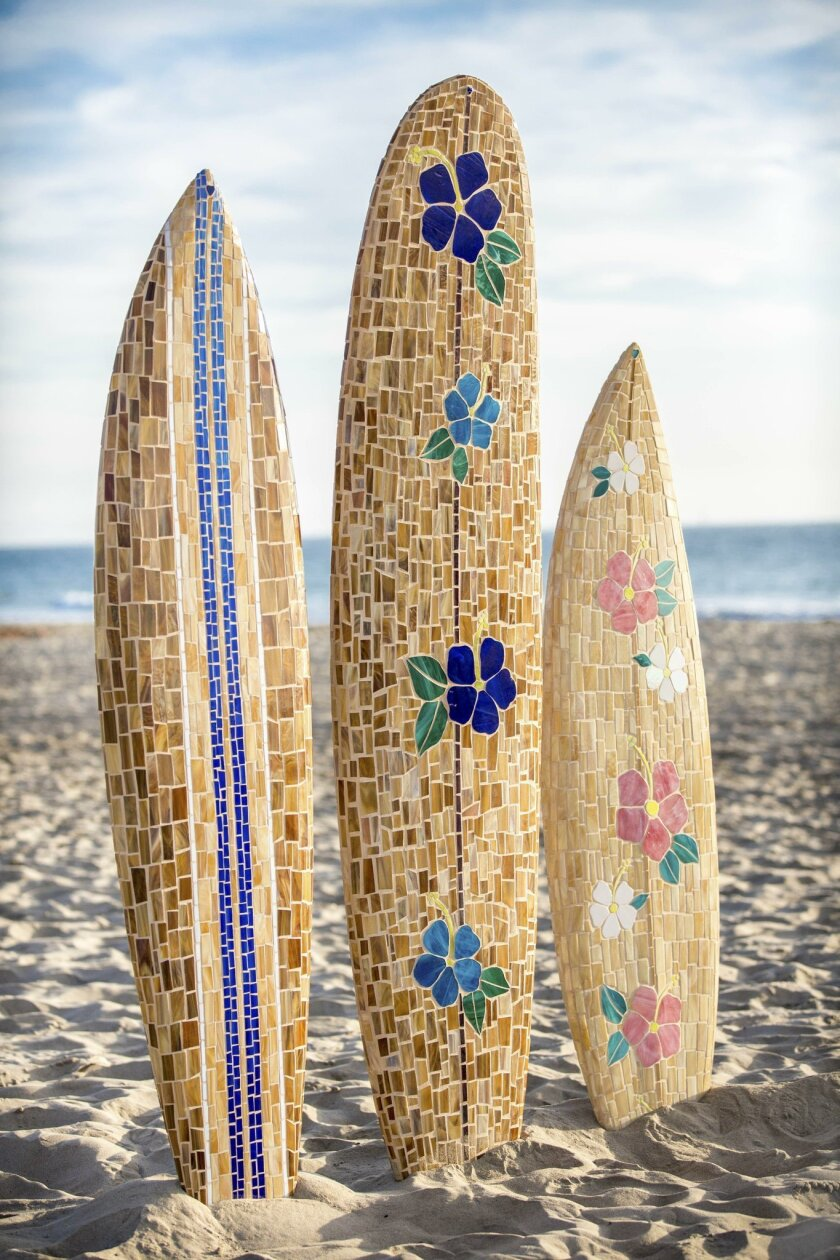 You don't have to live at the beach to add a mosaic surfboard to your decor.