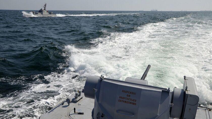 Two Ukrainian navy ships are seen near Crimea on Nov. 25.