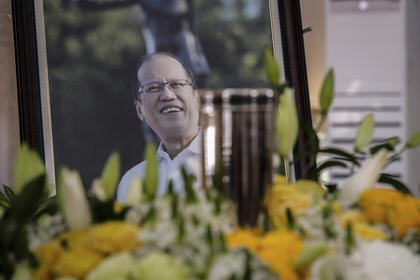 The urn of former President Benigno Aquino III is seen during a public viewing at the Church of Gesu of Ateneo de Manila University, in Quezon City, Philippines, Friday, June 25, 2021. Aquino, the son of pro-democracy icons who helped topple dictator Ferdinand Marcos and had troublesome ties with China, died Thursday, a cousin and public officials said. He was 61. (Mark Cristino/Pool Photo via AP)