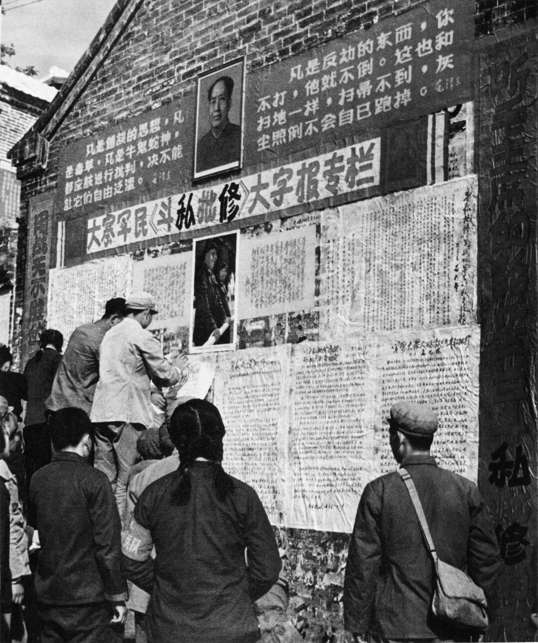 """Big character posters"" are put up by peasants and soldiers, circa 1970."