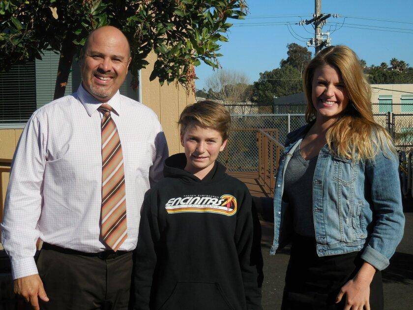 Principal Adam Camacho, Finn Mallery and Assistant Principal Kaitlin Wood.
