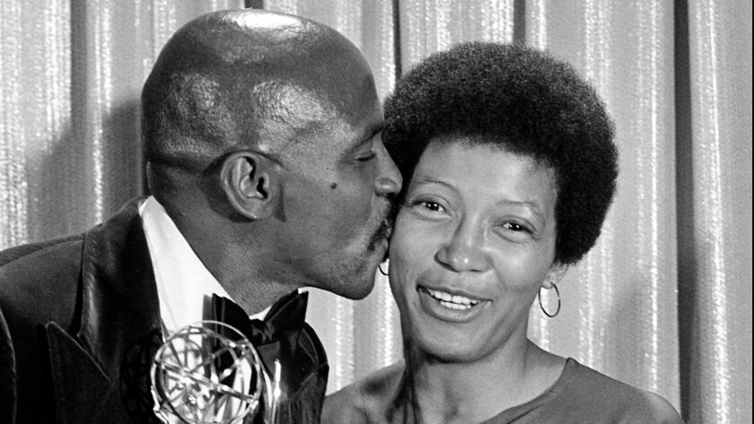 FILE - In this Sept. 11, 1977 file photo, Louis Gossett Jr., kisses his co-star Olivia Cole, as she