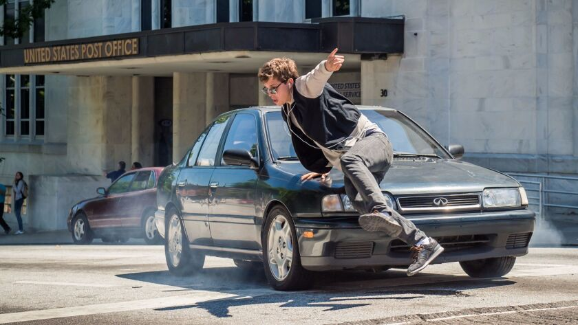 """Ansel Elgort as Baby dashes and dodges to his own personal soundtrack in """"Baby Driver"""" through the streets of Atlanta."""