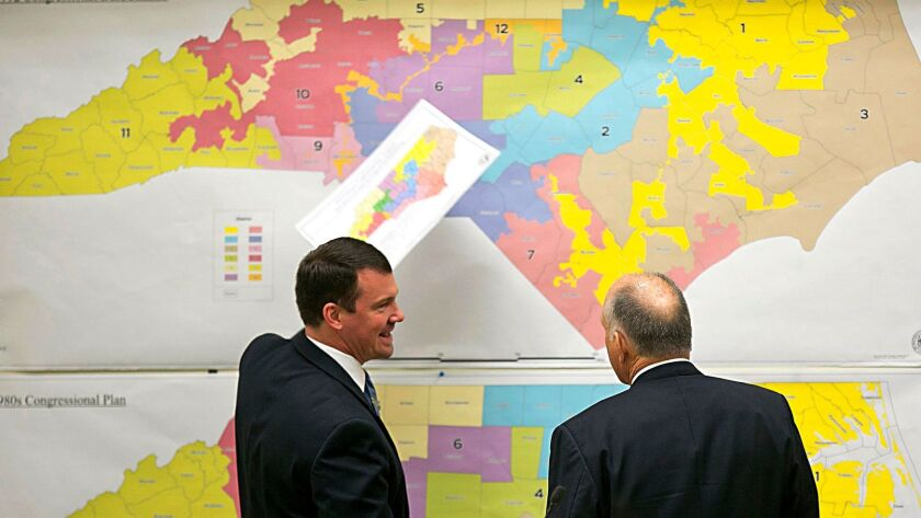 In North Carolina in 2016, Republican state Sens. Dan Soucek, left, and Brent Jackson review historical maps of the state.