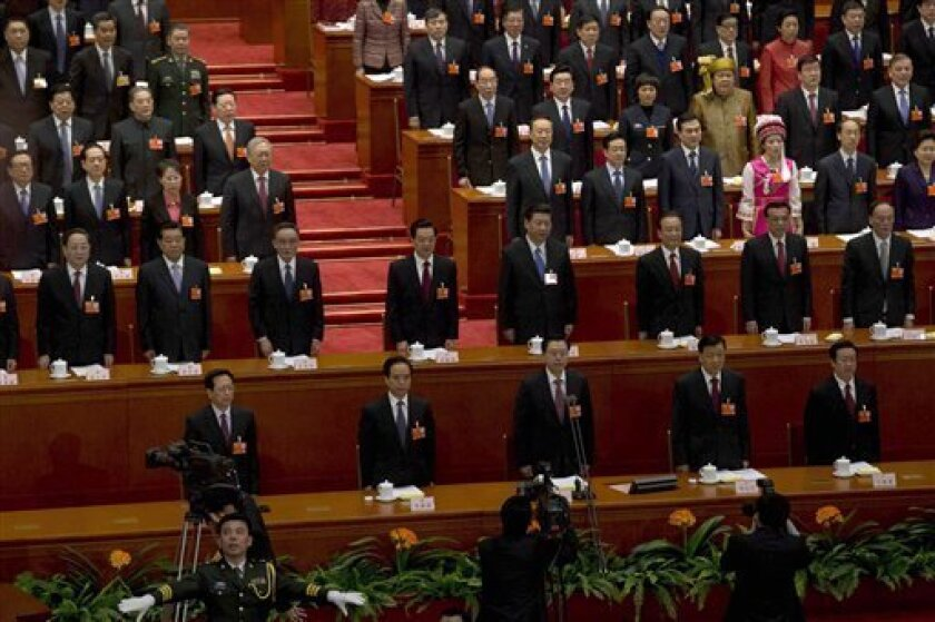China's top leaders stand for the national anthem at the opening session of the annual National People's Congress in Beijing's Great Hall of the People, China, Tuesday, March 5, 2013. China's government promised its people Tuesday deficit-fueled spending to fight corruption, improve the despoiled environment and address other quality-of-life issues that a growing number of Chinese are demanding. (AP Photo/Ng Han Guan)