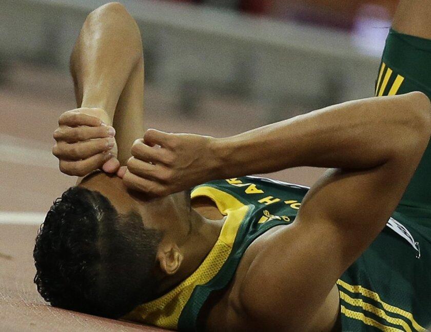 South Africa's Wayde Van Niekerk celebrates after winning the men's 400m final at the World Athletics Championships at the Bird's Nest stadium in Beijing, Wednesday, Aug. 26, 2015. (AP Photo/David J. Phillip)