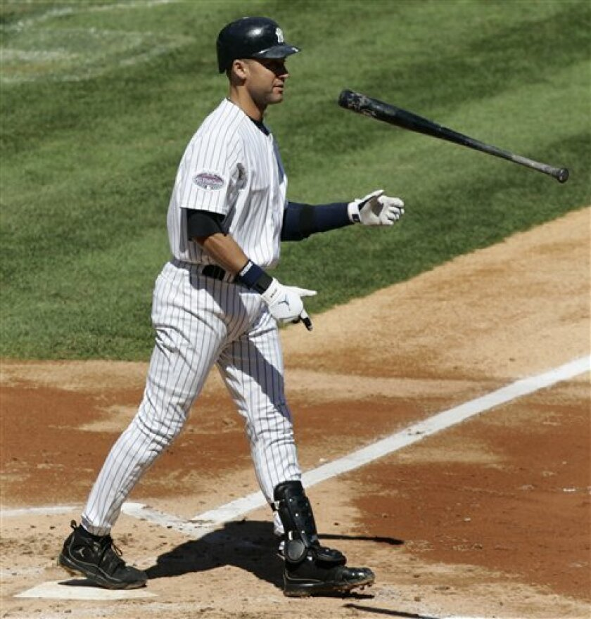 New York Yankees' Derek Jeter tosses his bat after striking out with the bases loaded to end the second inning against the Tampa Bay Rays in Major League Baseball action Saturday, April 5, 2008 at Yankee Stadium in New York. (AP Photo/Julie Jacobson)