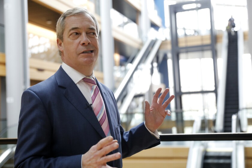 Britain's Nigel Farage, the leader of the Brexit Party, answers reporters at the European Parliament on Jan. 14, 2020, in Strasbourg, France.