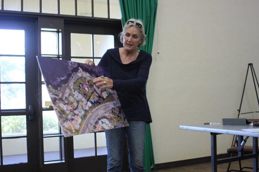 Melinda Merryweather shows her proposal for where a turnaround and two additional parking spaces could be added on Coast Walk.