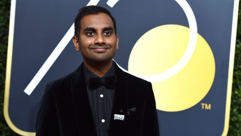 """Actor Aziz Ansari, the subject of a recent allegations of sexual impropriety, wears a """"Time's Up"""" pin at the Golden Globe Awards in Beverly Hills on Jan. 7."""