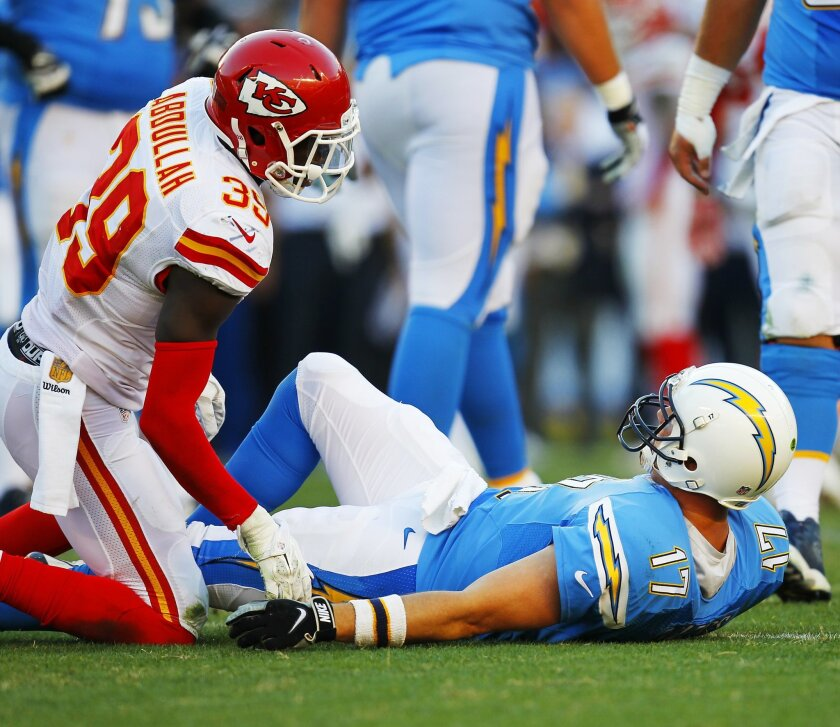 Chargers Philip Rivers looks up at Chiefs Husain Abdulla, who hit him in the 4th quarter.