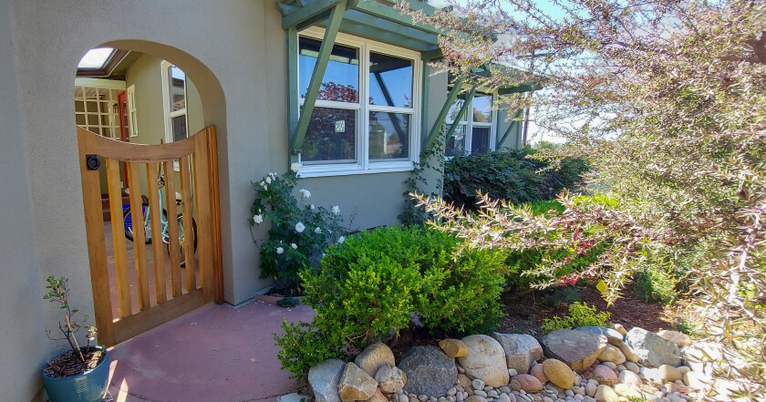 Outside the home, the team painted the stucco an identical sage green to match the existing exterior color.