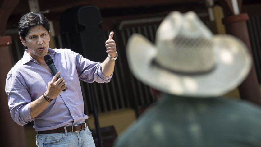 SOMIS, CALIF. -- SATURDAY, JULY 28, 2018: U.S. Senate candidate Kevin de Leon, left, addresses farme