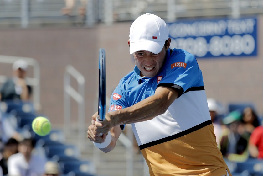 FILE - In this Aug. 30, 2019, file photo, Kei Nishikori, of Japan, returns a shot to Alex de Minaur, of Australia, during round three of the US Open tennis championships in New York. Nishikori tested positive for COVID-19 on Sunday, Aug. 16, 2020, and said he will pull out of the tuneup tournament at Flushing Meadows that starts next week. (AP Photo/Eduardo Munoz Alvarez, File)