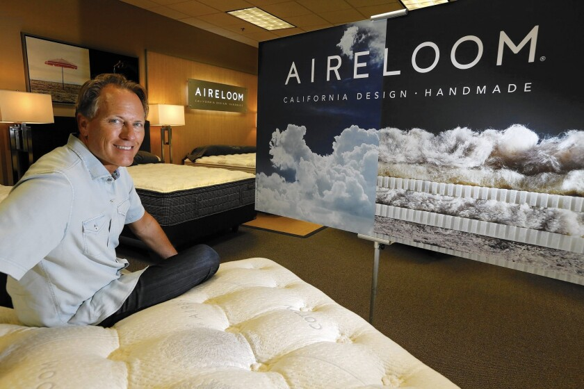 """David Long, E.S. Kluft's marketing director and self-described """"mattress geek,"""" at what he calls """"probably the most inefficient factory in the United States."""" The company encourages its workers to slow down."""