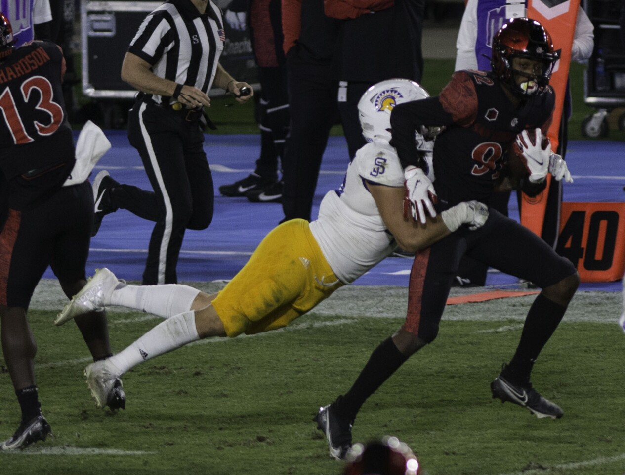 San Diego State's Kobe Smith is tackled by San Jose State's Kyle Harmon.