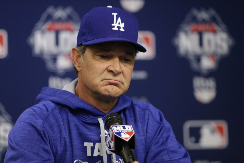 Dodgers Manager Don Mattingly speaks during a news conference before Game 3 of the National League division series against the Mets in New York on Oct. 12.