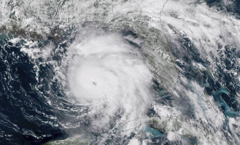 FILE-This Tuesday, Oct. 9, 2018 file satellite image provided by NOAA shows Hurricane Michael, center, in the Gulf of Mexico. Weather forecasters have posthumously upgraded last fall's Hurricane Michael from a Category 4 storm to a Category 5. The National Oceanic and Atmospheric Administration announced the storm's upgraded status Friday, making Michael only the fourth storm on record to have hit the U.S. as a Category 5 hurricane. (NOAA via AP)