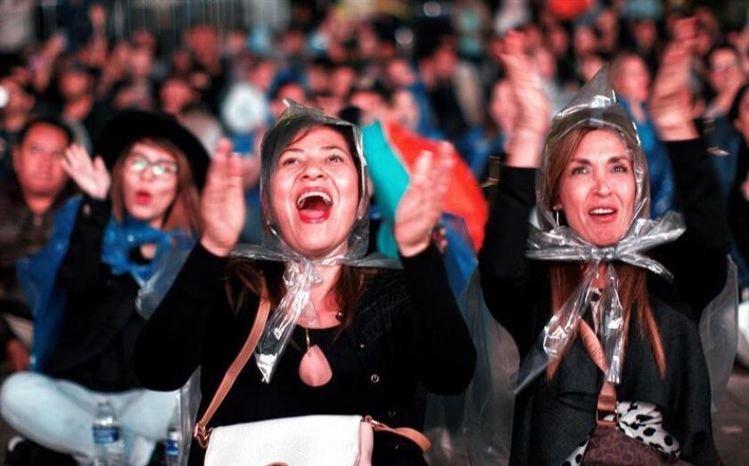 Dozens of people celebrate the Oscar for best photography during the live broadcast of the Oscar's Awards, in Mexico City, Mexico, Feb. 24, 2019. EPA-EFE/Madla Hartz