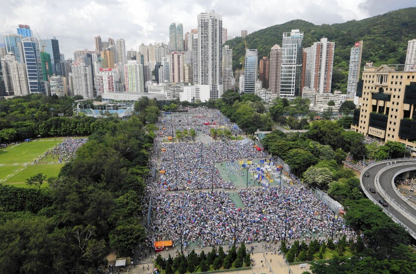 Thousands march through downtown Hong Kong on July 1 in an annual pro-democracy protest.
