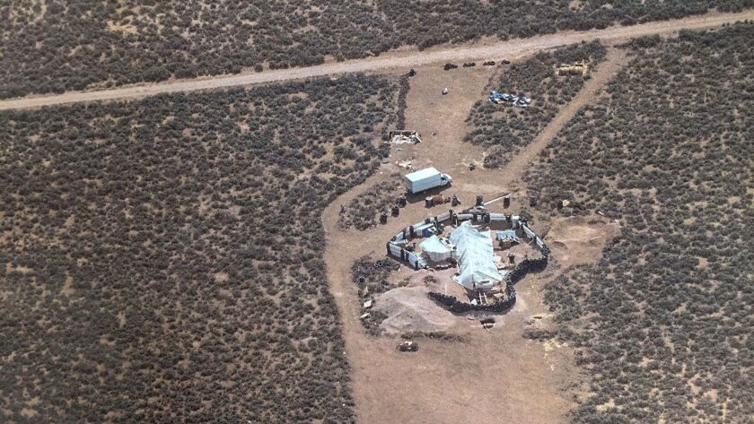 A photo released by the Taos County Sheriff's Office shows a rural compound during a search for a missing boy in Amalia, N.M.