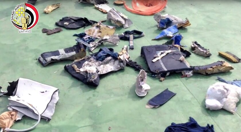 FILE - This file still image taken from video posted Saturday, May 21, 2016, on the official Facebook page of the Egyptian Armed Forces spokesman shows some personal belongings and other wreckage from EgyptAir flight 804 in Egypt. Human remains retrieved from the crash site of EgyptAir Flight 804 s