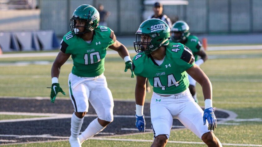 Justin Flowe (No. 10) and Jonathan Flowe (No. 44) await a snap against La Habra on Aug. 22.