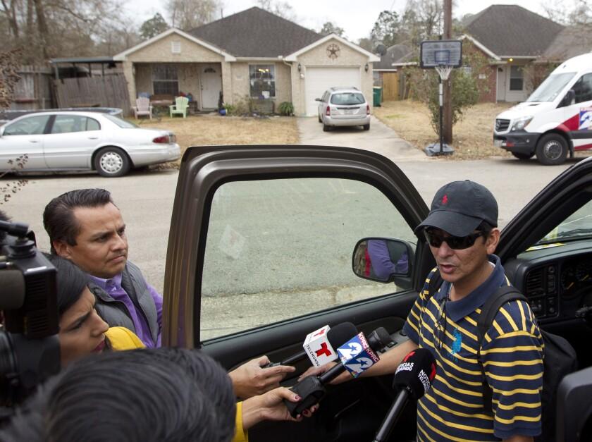 FILE - In this Jan. 26, 2018, file photo, Ernesto Valladares, brother of Ulises Valladares, speaks to the media across from his brother's home where Ulises and his son were bound by a pair of men and then Ulises was taken away by the kidnappers and later killed Valladares during an FBI raid in Conroe, Texas. A recent appeals court ruling that provided immunity for the FBI agent who fatally shot the kidnapped Houston area man during a botched rescue attempt is being legally challenged, the man's family and attorney said Tuesday, May 4, 2021. (Jason Fochtman/Houston Chronicle via AP, File)