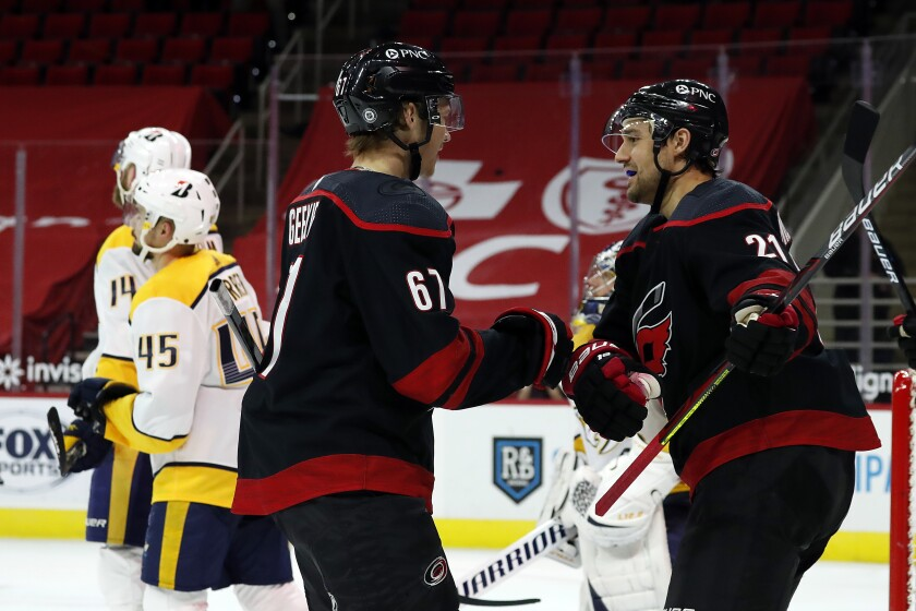 Carolina Hurricanes' Morgan Geekie (67) is congratulated by Nino Niederreiter (21) after his second goal of the night, during the second period of the team's NHL hockey game against the Nashville Predators in Raleigh, N.C., Thursday, March 11, 2021. (AP Photo/Karl B DeBlaker)