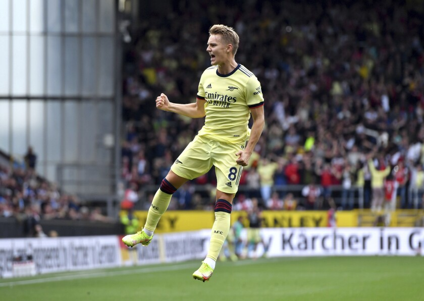Arsenal's Martin Odegaard celebrates scoring their side's first goal of the game against Burnley during their English Premier League soccer match at Turf Moor in Burnley, England, Saturday Sept. 18, 2021. (Anthony Devlin/PA via AP)