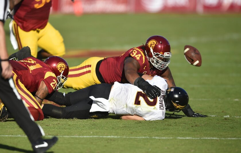 Southern California defensive end Leonard Williams (94) sacks Arizona State quarterback Mike Bercovici during the first half of an NCAA college football game, Saturday, Oct. 4, 2014, in Los Angeles. (AP Photo/Gus Ruelas)