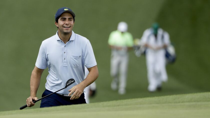 Alvaro Ortiz walks up to the seventh green during a practice round for the Masters golf tournament M