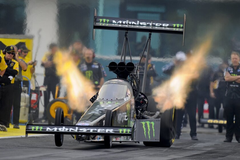 In this photo provided by NHRA, Brittany Force races in her Monster Energy dragster at the Amalie Motor Oil Gatornationals in Gainesville, Fla., Friday, March 18, 2016. (Jerry Foss/NHRA via AP)
