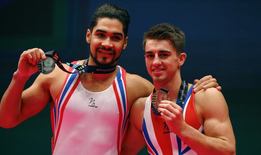 Winner Britain's Max Whitlock, right, and second placed teammate Britain's Louis Smith pose with their medals after winning the pommel horse exercise during the men's apparatus final competition at the World Artistic Gymnastics championships at the SSE Hydro Arena in Glasgow, Scotland, Saturday, Oc