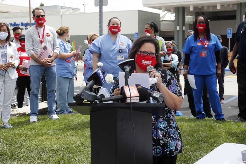 Respiratory therapist Christina Rodriguez, speaks outside of Fountain Valley Regional Hospital's emergency room on Thursday.