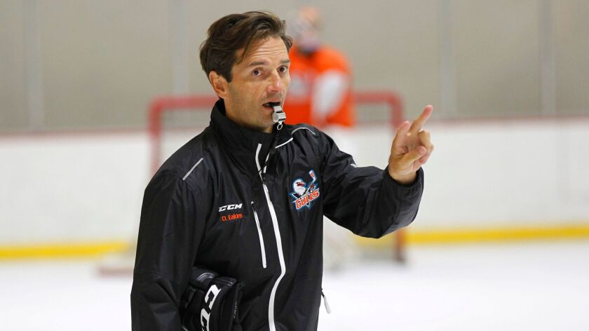 San Diego Gulls Coach Dallas Eakins instructs players Oct. 3 during practice at the Poway Ice Arena. Eakins emphasizes fitness for a team that's become one of the hottest in the AHL.