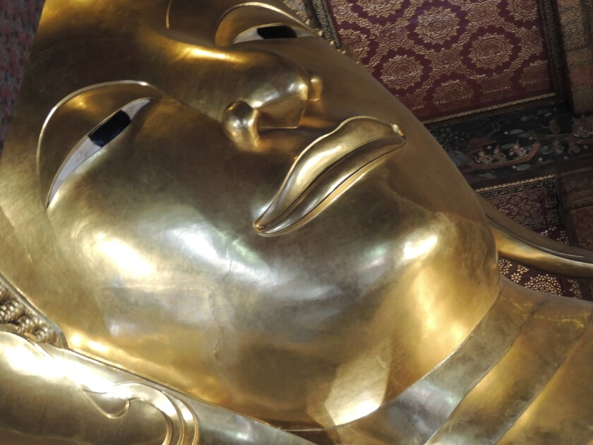 The face of the Reclining Buddha in Bangkok.