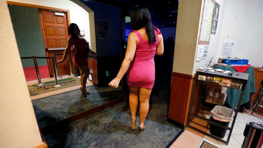 A contestant checks herself out in a mirror at a nightclub in southeast L.A.