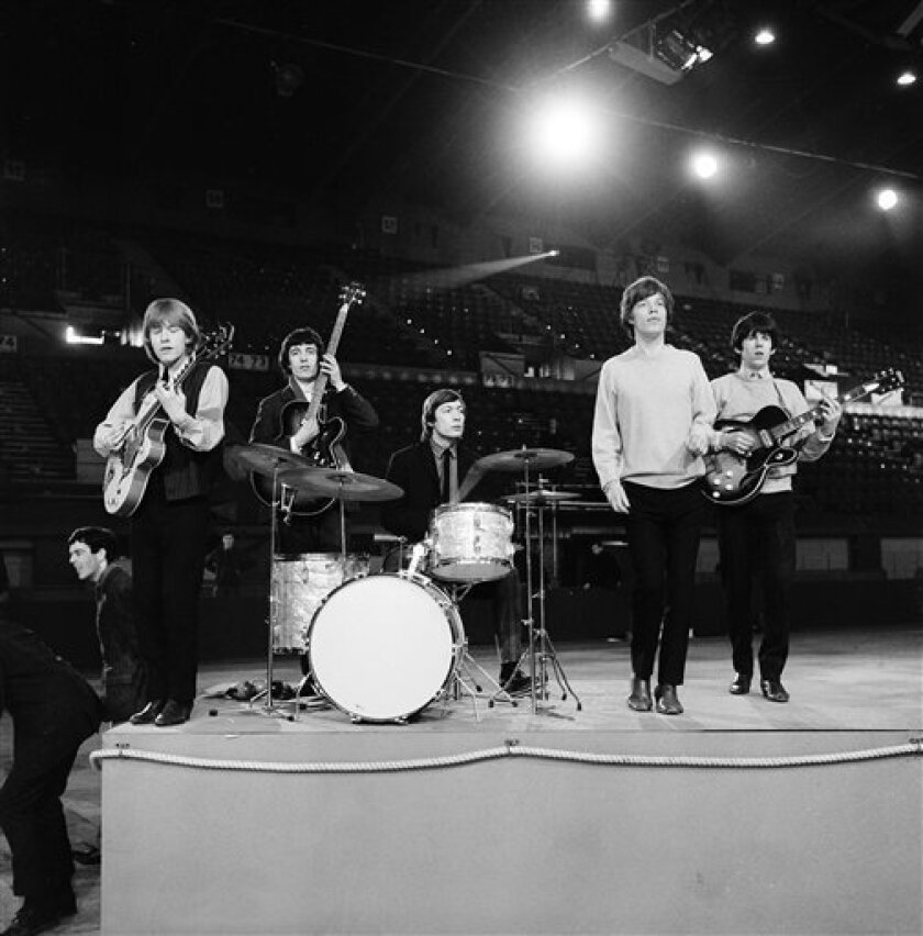 FILE - This April 8, 1964 file photo shows The Rolling Stones during a rehearsal at an unknown location. The British band members, from left, are, Brian Jones, guitar; Bill Wyman, bass; Charlie Watts, drums; Mick Jagger, vocals; and Keith Richards, guitar. (AP Photo, File)