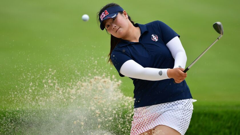 Angel Yin of Team USA plays a bunker shot during practice prior to The Solheim Cup at Des Moines Golf and Country Club on August 17, 2017 in West Des Moines, Iowa.