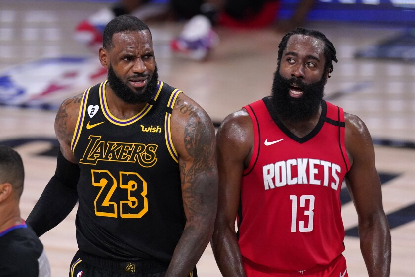 Lakers forward LeBron James  and Houston Rockets forward James Harden react to a call.