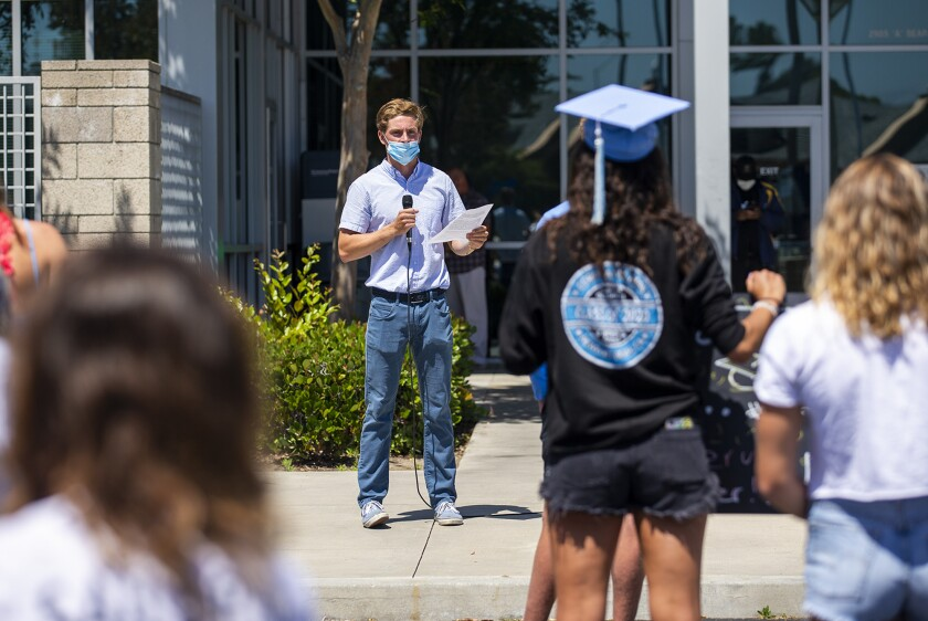 Seniors protest the Newport-Mesa Unified School District's decision to not hold in-person graduation ceremonies this year.