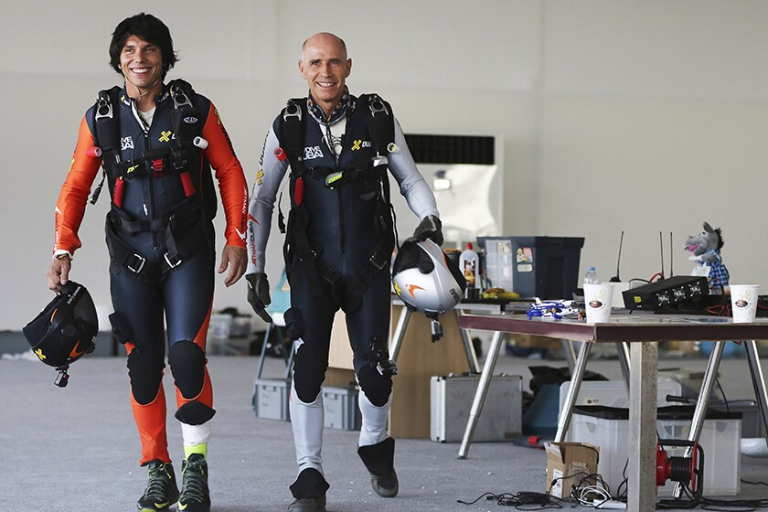Vincent Reffet, left, and Yves Rossy gear up in 2015.