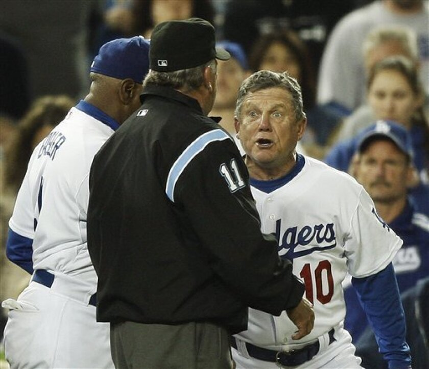 Los Angeles Dodgers third base coach Larry Bowa argues with third base umpire Ed Montague after being thrown out of the game by Montague during the sixth inning of an MLB baseball game at Dodger Stadium in Los Angeles Tuesday, April 1, 2008. (AP Photo/Kevork Djansezian)