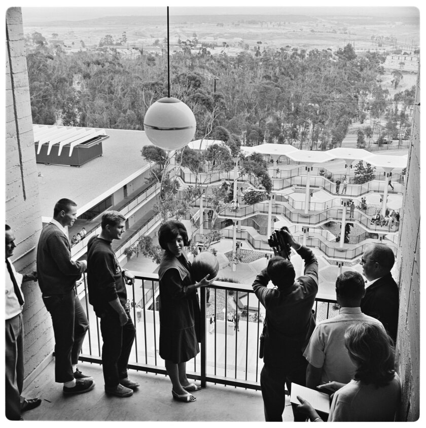 """The university's first watermelon drop, now an annual campus tradition, was held in 1965. The school's first watermelon drop """"queen"""" prepares to toss one off a balcony. UCSD"""