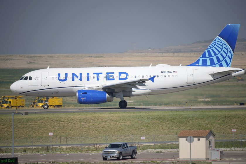 A United Airlines jetliner taxis down a runway for take-off from Denver International Airport in Denver.