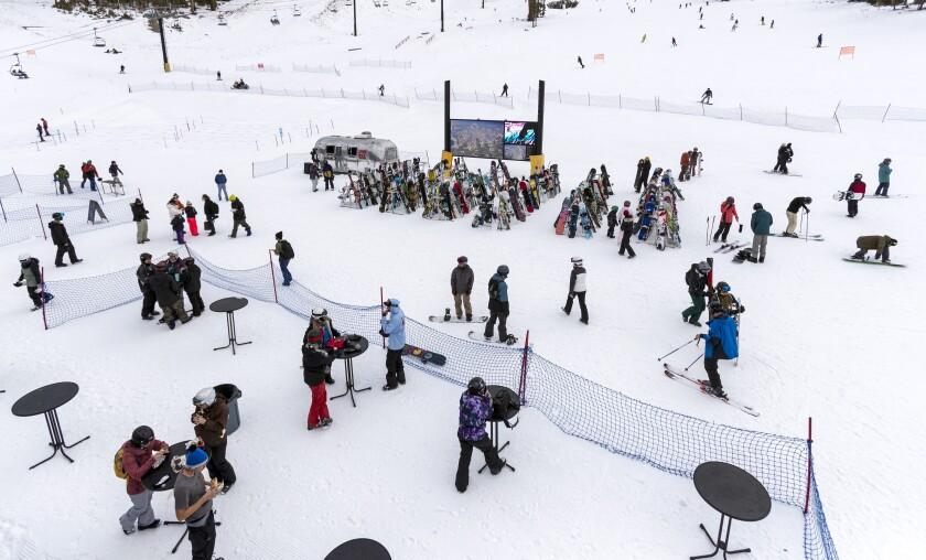 Tables have been moved outside for skiers and snowboarders to eat and social distance at Mammoth Mountain.