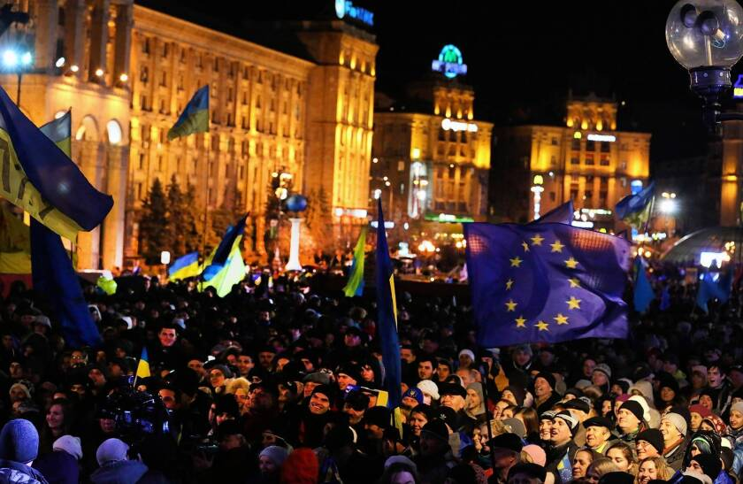 Demonstrators, some waving Ukrainian and European Union flags, gather in Kiev's Independence Square to denounce President Viktor Yanukovich's rejection of an association agreement with the EU.