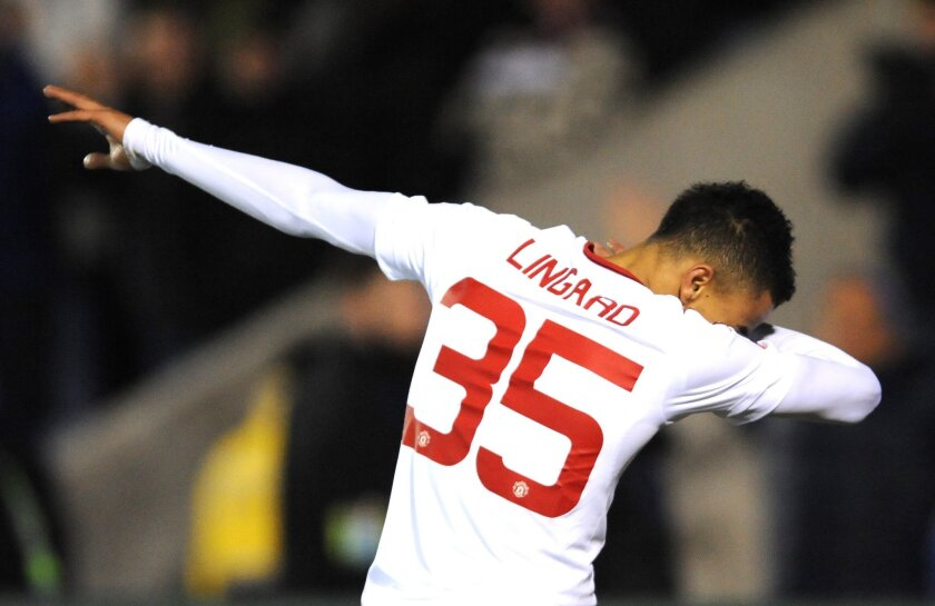 Manchester United's Jesse Lingard celebrates after scoring during the English FA Cup fifth round soccer match between Shrewsbury Town and Manchester United at Greenhous Meadow stadium in Shrewsbury, England, Monday, Feb. 22, 2016. (AP Photo/Rui Vieira)